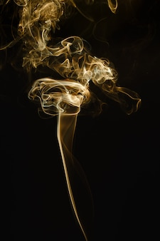 Smoke floating in the air on dark background