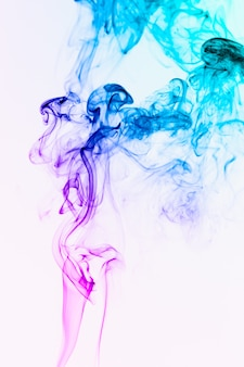 Smoke floating colorful in the air on white background