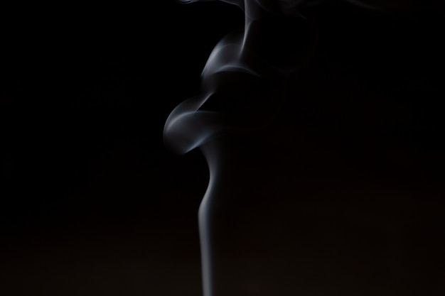 Smoke from aromatherapy incense sticks with the smell of sandalwood and essential oil in chinese medicine.