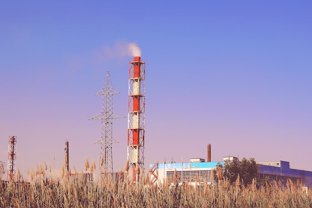 Smoke industrial chimney. pipes pollutes atmosphere city. environment, emissions water resources.