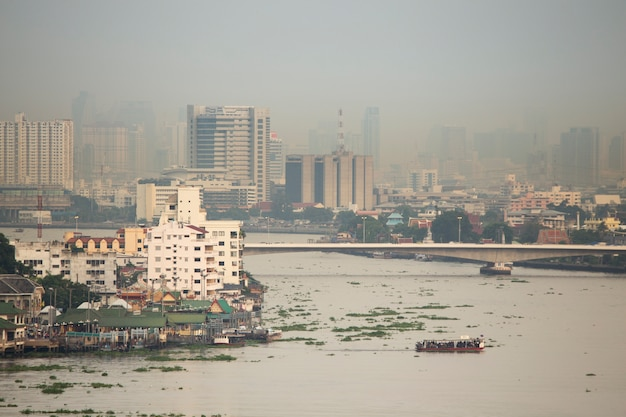 Smoke and pollution haze cover  bangkok city of thailand on evening