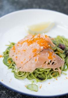 Smoke salmon with green sauce spaghetti