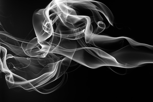Smoke the white incense on a black background