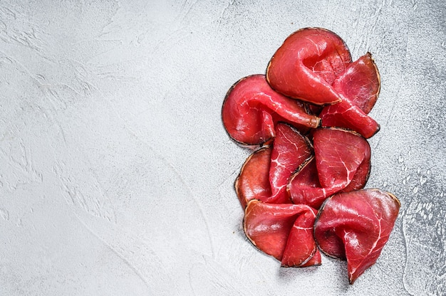 Smoked bresaola beef cut pieces, italian antipasti