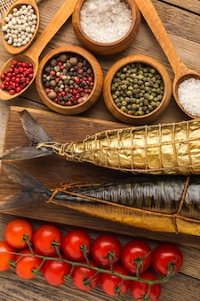Smoked fishes and spices  flat lay