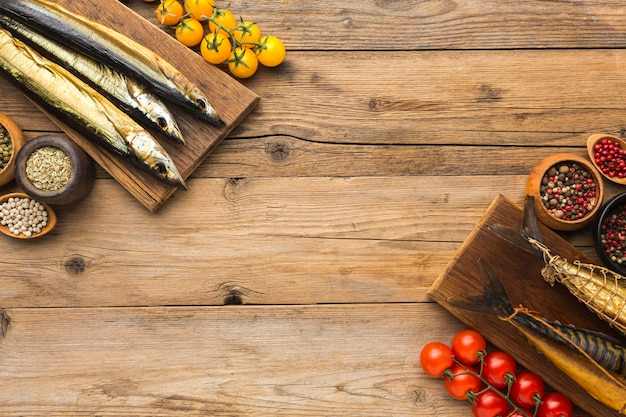 Smoked fishes on wooden table top view