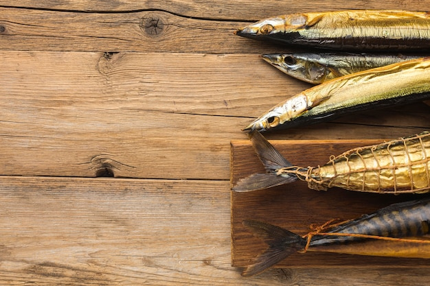 Smoked fishes on wooden table