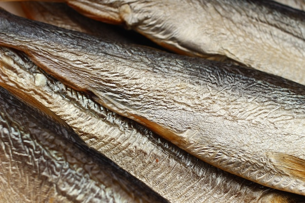Smoked herring close up on a white background