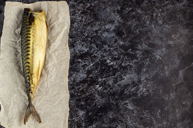 Smoked mackerel without head on baking paper