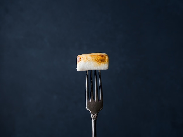 Smoked marshmallow on fork