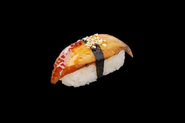 Smoked nigiri sushi eel, unagi sauce, sesame seeds isolated