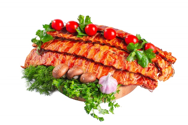 Smoked pork ribs with tomatoes and greens
