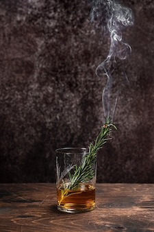 Smoked rosemary in a glass of whiskey or bourbon