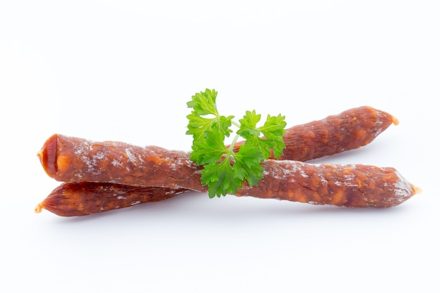 Smoked sausage salami isolated on a white background.