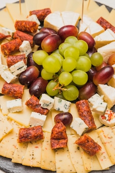 Smoked sausages with cheese platter and grapes