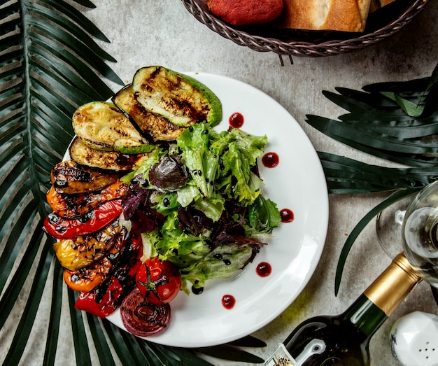 Smoked vegetables aubergine tomato bell peppers served with lettuce salad