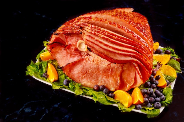 Smoked whole pork ham with fresh fruits. healthy food. close up.