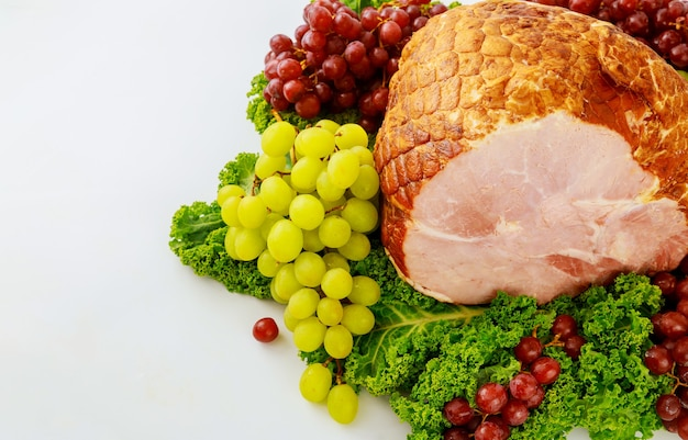 Smoked whole pork ham with fresh fruits. healthy food. easter meal.