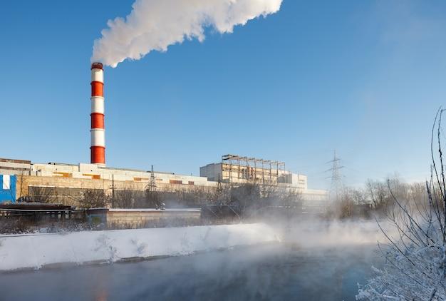 Smokestack pipe thermal station in winter