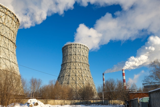 Smokestack tower thermal power station in winter