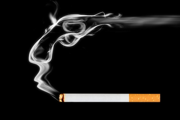 Smoking cigarette on black background.commit suicide
