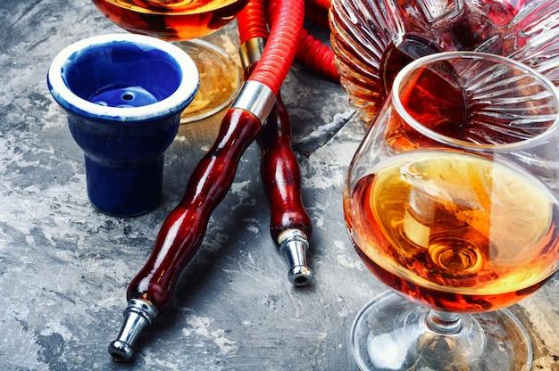 Smoking hookah with cognac flavor