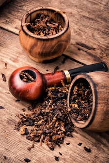 Smoking pipe on wooden table