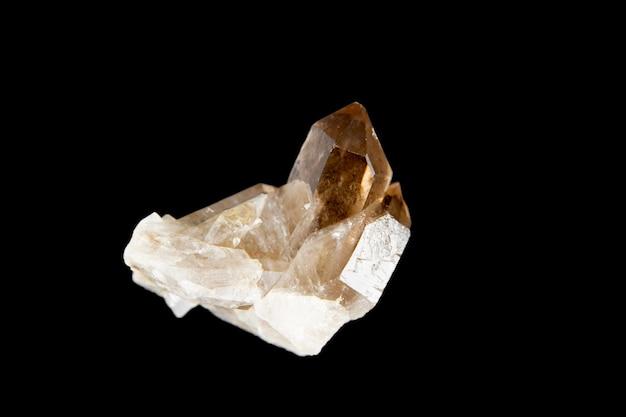 Smoky quartz gemstone isolated on a black background