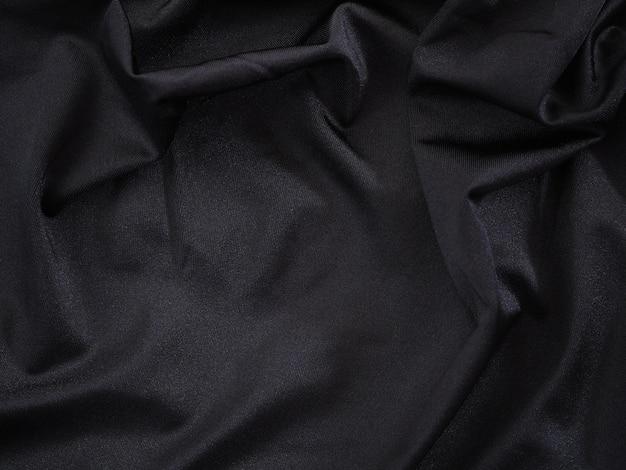 Гладкая черная шелковая или атласная роскошная текстура для свадебного фона.