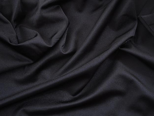 結婚式のための滑らかな黒い絹またはサテンの豪華なテクスチャ