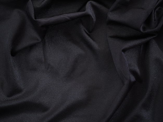 Smooth black silk or satin luxury texture for wedding background.