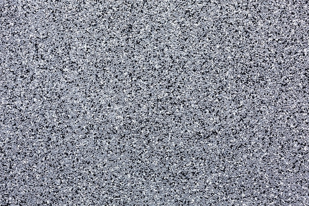 Smooth dark grey asphalt pavement texture