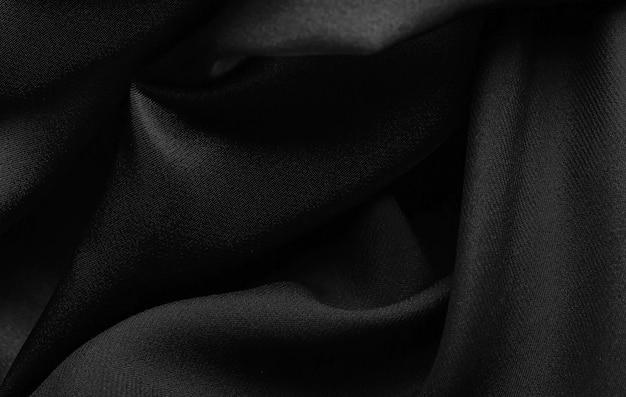 滑らかでエレガントな黒のサテンの背景