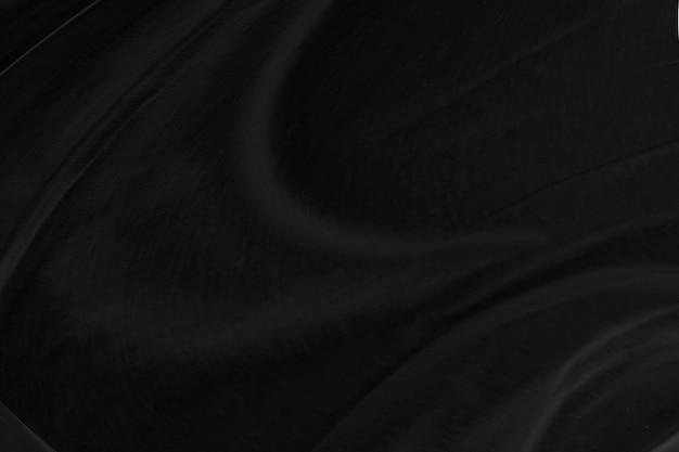 滑らかでエレガントな黒のシルク生地またはサテンの高級布の質感