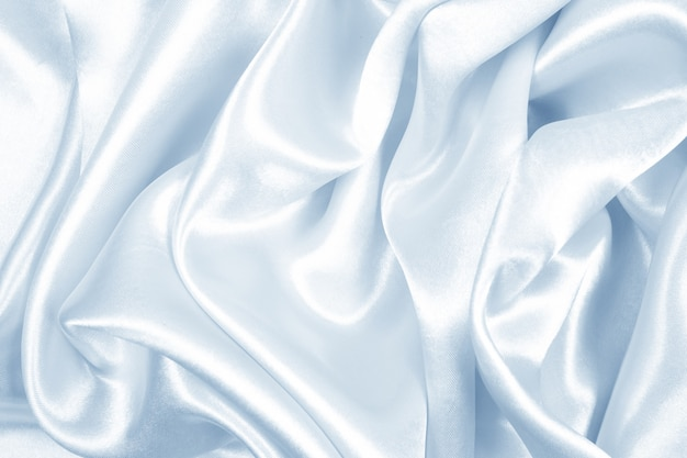 Smooth elegant blue silk or satin texture can use as abstract background, fabric