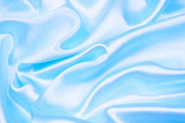 Smooth elegant blue silk or satin texture can use as abstract background
