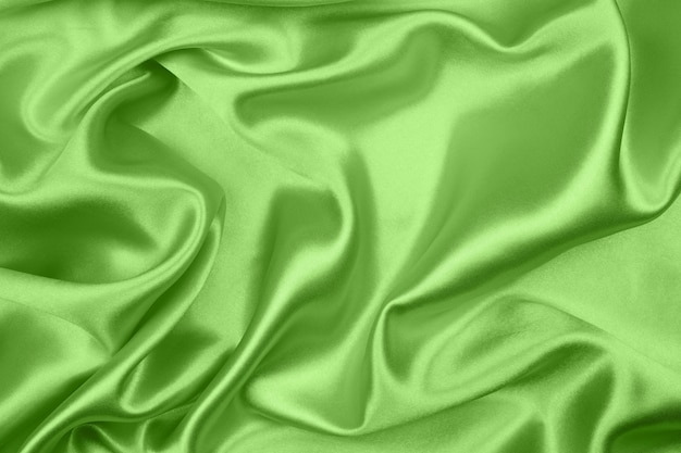 Smooth elegant green silk or satin texture can use as abstract background, fabric design