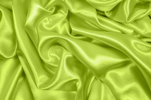 Smooth elegant green silk or satin texture can use as background, fabric