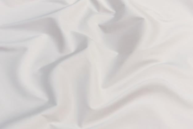 滑らかでエレガントな灰色の生地の質感は、デザインの抽象的な背景として使用できます。贅沢なパターン