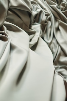 Smooth elegant grey silk or satin texture can use background