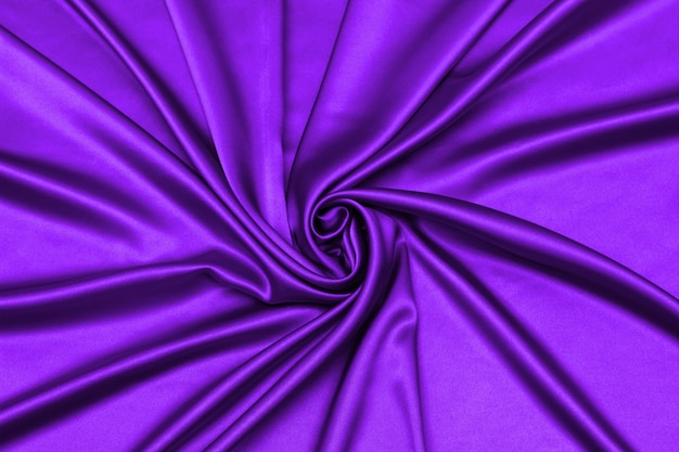 Smooth elegant purple silk or satin luxury cloth texture can use as abstract background.