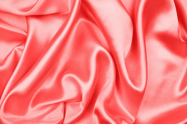 Smooth elegant red silk or satin texture can use as abstract background, fabric