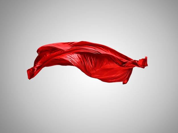 Гладкая элегантная прозрачная красная ткань разделена на сером фоне. текстура летящей ткани.