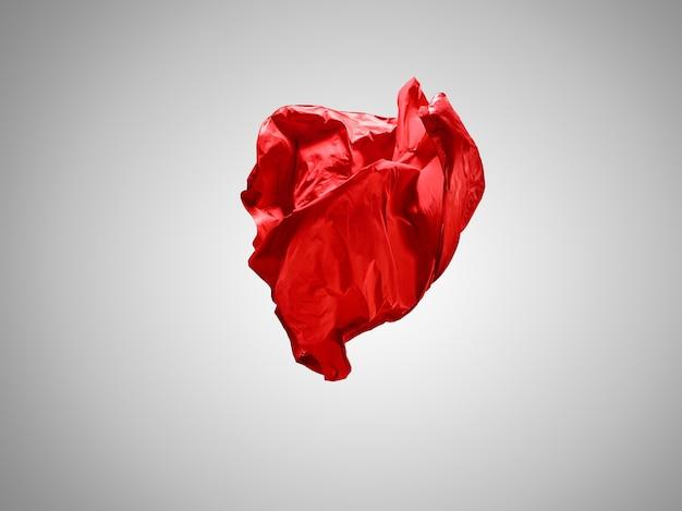 Гладкая элегантная прозрачная красная ткань разделена на сером фоне.