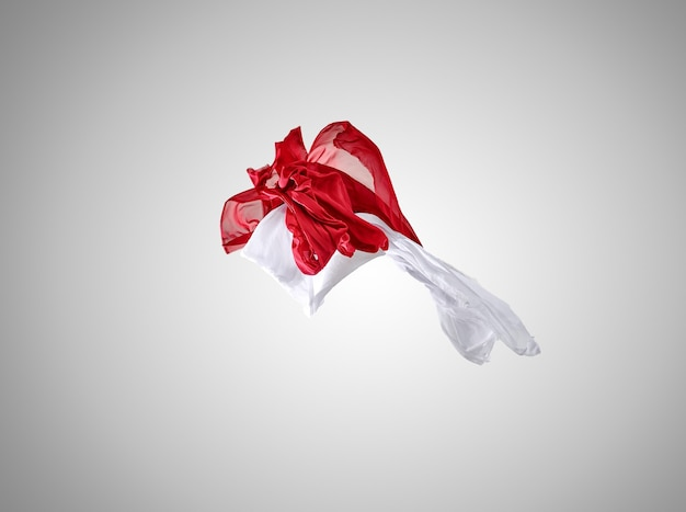 Smooth elegant transparent red and white cloth separated on gray background.