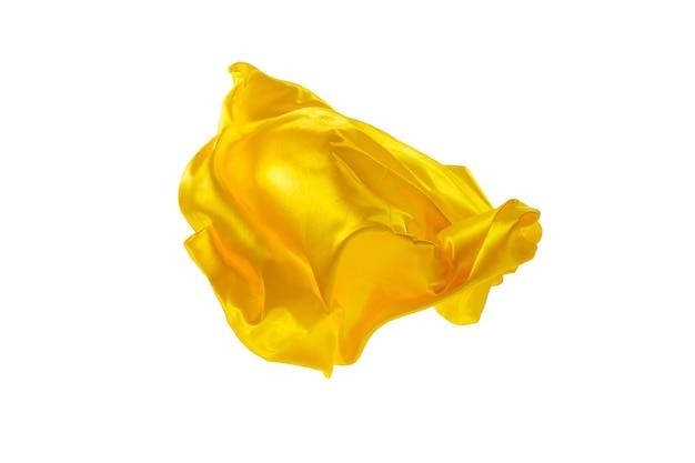 Гладкая элегантная прозрачная желтая ткань разделена на белом фоне.