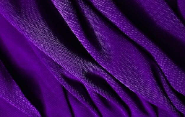 Гладкую элегантную фиолетовую атласную текстуру можно использовать в качестве абстрактного фона. роскошный дизайн фона. фиолетовая текстура крупным планом
