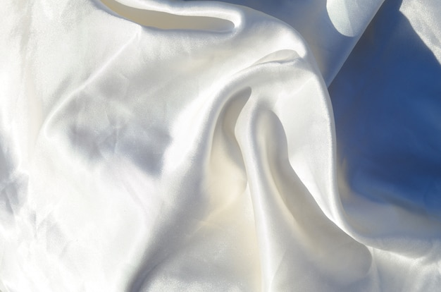 Smooth elegant white silk or satin luxury cloth texture can use as wedding background.