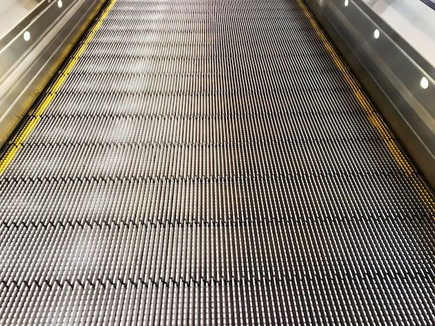 Smooth escalator for shopping cart in the mall or airport.