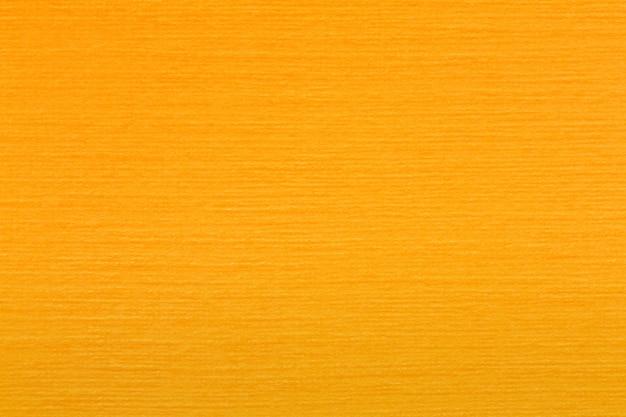 滑らかなライトオレンジフェルト生地の背景テクスチャ上面図